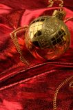 Gold baubles with red backdrop Stock Image