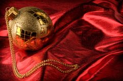 Gold baubles with red backdrop Stock Photos