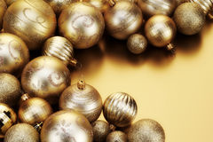 Gold Baubles. Various designs of Gold Baubles on golden background Stock Image