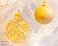 Gold baubles on white. Royalty Free Stock Photography