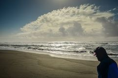 Gold Beach Oregon. Beachcomber bracing for the storm in Gold Beach, Oregon, USA Royalty Free Stock Image