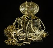 Gold Beaded Necklaces on Gold Jewelry Box Royalty Free Stock Images