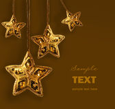 Gold beaded stars isolated on white Stock Images