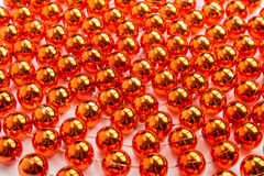 Gold beads close-up background Royalty Free Stock Images