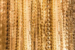 Gold beads and crystals on strings Royalty Free Stock Images