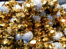 Gold Beads. Golden beads at the flea markets in Chinatown, Los Angeles, California Royalty Free Stock Photos