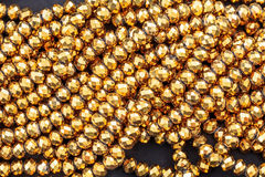 Gold Beads necklace. For background Royalty Free Stock Photos