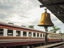 Gold bell at railway station local in thailand stock image