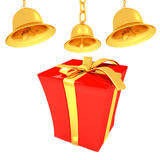Gold bell and red gift box with golden ribbon Royalty Free Stock Photography
