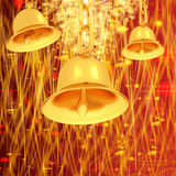 Gold bell on winter or Christmas style background with a wave of stars Royalty Free Stock Images