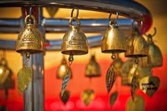 Gold bells. Golden bells hanging on a temple in Bangkok Stock Images