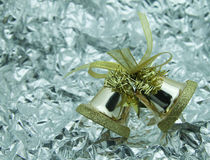 Gold bells. Gold bells with silver background Royalty Free Stock Images