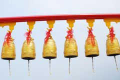 Gold Bells at Chinese temple in Thailand. Royalty Free Stock Photo