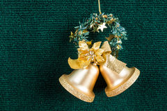Gold bells on green carpet Royalty Free Stock Photo