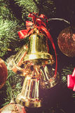 Gold bells and red bow decorations Stock Images