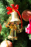 Gold bells and red bow decorations Stock Photo