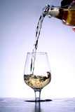 Gold beverage. A glass of gold beverage Royalty Free Stock Images