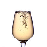 Gold beverage. A full glass of gold beverage Stock Image