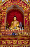 Gold bhudda on the wall Stock Photography