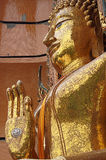Gold big buddha statue, seated in the posture of giving blessings Stock Photos