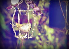 Gold bird in cage in vinatge style Stock Images