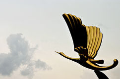 Gold bird statue royalty free stock image