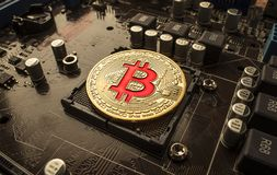 Gold Bit Coin BTC coins on the motherboard. Bitcoin is a worldwi Royalty Free Stock Photography
