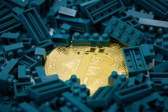 A gold bit coin in the middle of a green jug block. Communications to Invest in the Digital Market.using as background business co. Ncept with copy space Royalty Free Stock Images