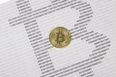 Gold bitcoin on the background of binary code. Electronic money and cryptocurrency stock photo