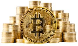 Gold bitcoin on a background of rising columns of coins Royalty Free Stock Photos