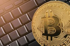 Gold bitcoin on black keyboard computer background. Gold bitcoin on black keyboard computer background in concept of cryptocurrency idea for design in your work Royalty Free Stock Photography
