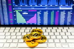 Gold bitcoin and BTC trading chart background. Virtual currency concept.  Stock Photography