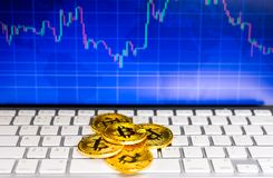 Gold bitcoin and BTC trading chart background. Virtual currency concept Royalty Free Stock Photos