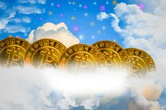 Gold bitcoin, on the clouds, blue sky, with colorful stars as the background. stock photography