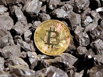 Gold bitcoin on a coal`s background. Mayerized Crypto currency. Payroll through the Internet. To drip crypto currency bitcoin. The. Ban on crypto-currency stock photo
