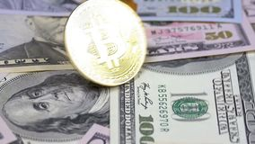 Gold Bitcoin Coin BTC Rotate, Twist, Swirling, Spinning and Falls on the Table with Dollars. Slow Motion. Gold Bitcoin Coin BTC Rotate, Twist, Swirling, Spinning stock video