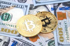 Gold bitcoin coins on one hundred US dollar bills background. Cryptocurrency, New digital currency, Bitcoin exchange to dollar money banknotes and accepted to Royalty Free Stock Image
