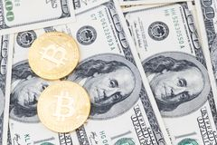 Gold bitcoin coins on one hundred US dollar bills background. Cryptocurrency, New digital currency, Bitcoin exchange to dollar money banknotes and accepted to Stock Images