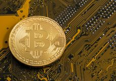 Gold bitcoin concept - computer circuit board with bitcoin processor. And microchips. Electronic currency, Internet finance Stock Image