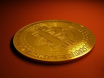 Gold Bitcoin digital currency. Bitcoin decentralized digital unregulated cryptocurrency generated from peer to peer network mining in both background and Royalty Free Stock Images