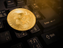 Gold Bitcoin. Digital currency, financial industry, Bitcoin Golden on keyboard Royalty Free Stock Photography