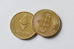 Gold Bitcoin and Etherium Token. A gold Bitcoin and Etherium Token royalty free stock photo