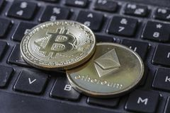 Gold Bitcoin and Etherium Token On Keyboard.  stock photography