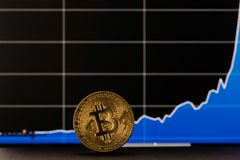 Gold bitcoin. Bitcoin exchange rate in the background. royalty free stock photo