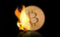 Gold bitcoin on fire over black background. Cryptocurrency, digital currency, finance and business concept - gold bitcoin on fire over black background Royalty Free Stock Images