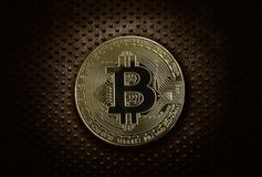 Gold bitcoin on grunge metal. Gold bitcoin on industrial grunge metal background Stock Photography