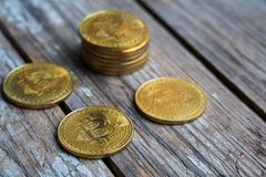 Gold Bitcoin money on wooden table. Electronic crypto currency. Business concept royalty free stock images