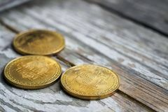 Gold Bitcoin money on wooden table. Electronic crypto currency. Business concept royalty free stock photo