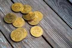 Gold Bitcoin money on wooden table. Electronic crypto currency. Business concept royalty free stock photography