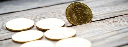 Gold Bitcoin money on wooden table. Electronic crypto currency. Business concept stock photography